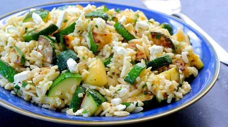 Lightly sautéed zucchini tossed with orzo, feta, lemon,