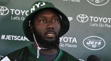 Jets' Muhammad Wilkerson speaks with media after a