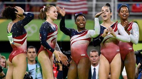 From left, Lauren Hernandez, Madison Kocian, Simone Biles,