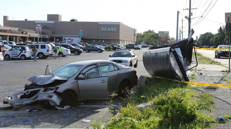 Nassau Police investigate after a car crashed through
