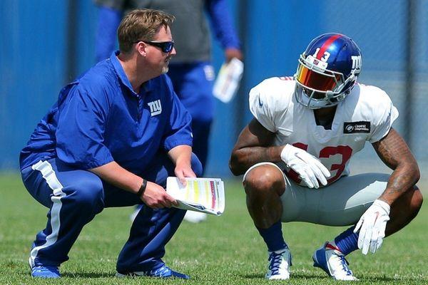 Giants coach Ben McAdoo talks with Odell Beckham