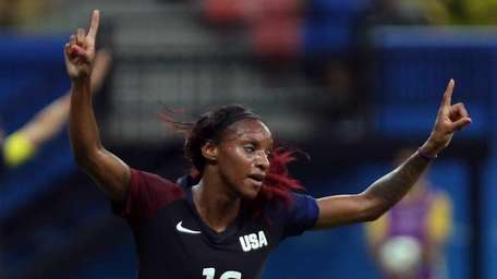 United States' Crystal Dunn, center, celebrates scoring her