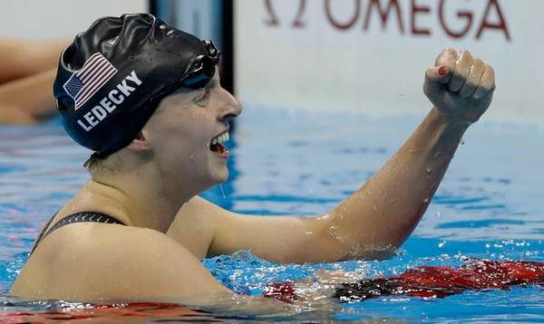 The United States' Katie Ledecky celebrates winning the