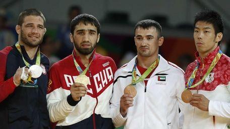 From left, U.S. Travis Stevens (silver), Russia's Khasan