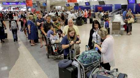 Delta passengers stand in line at Salt Lake