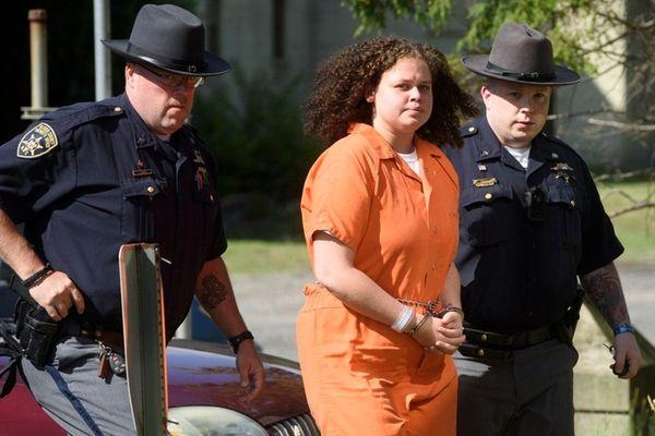 Sheriff deputies walk Sarra Gilbert into a courthouse