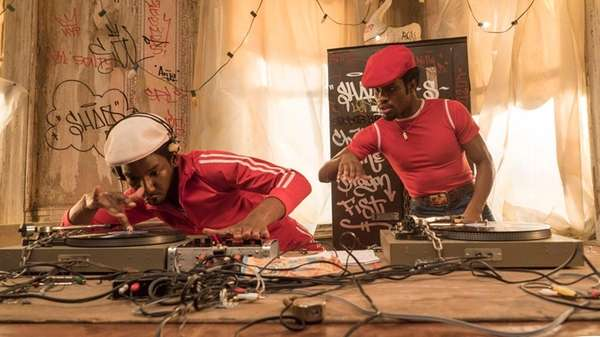 Mamoudou Athie, as Grandmaster Flash (left) and Shameik