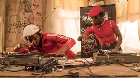 Mamoudou Athie, as Grandmaster Flash (left) and Shameik