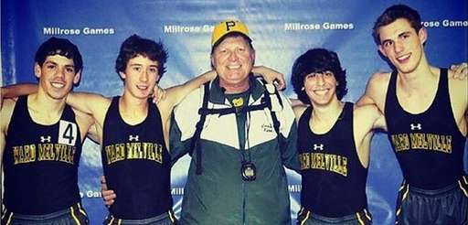 Coach Robert Kerr, center, with athletes after a