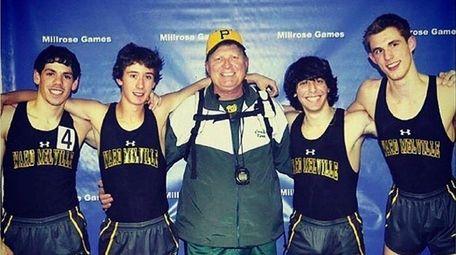 Coach Robert Kerr, center, with athletes after a