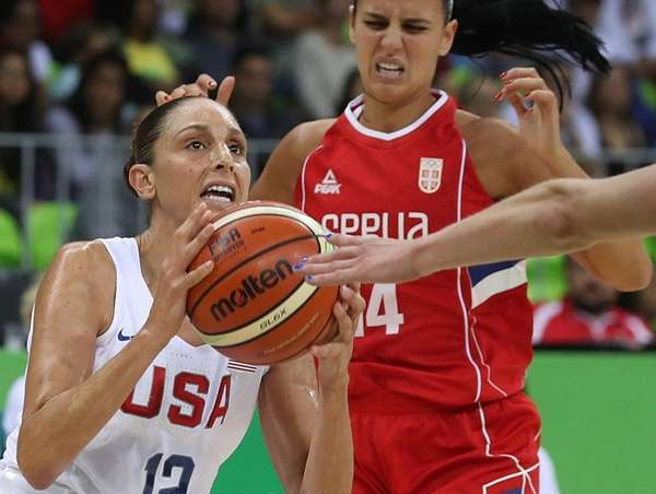 US rolls on, routs Serbia in Olympic women's basketball