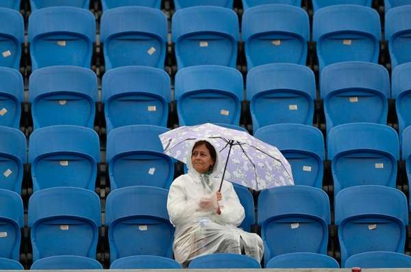 A spectator sits in a tribune during a