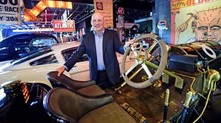 Howard Kroplick with his classic car collection in