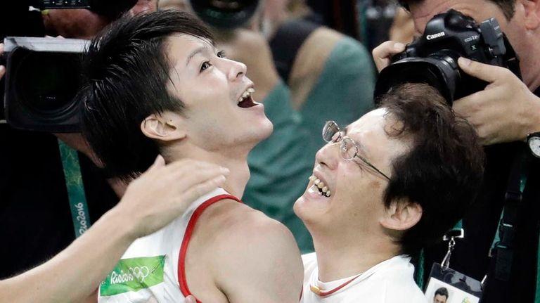 Japan's Kohei Uchimura celebrates after seeing the final