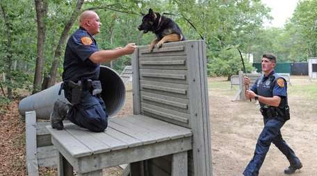 Suffolk County police canine officer Thomas Teufel, left,