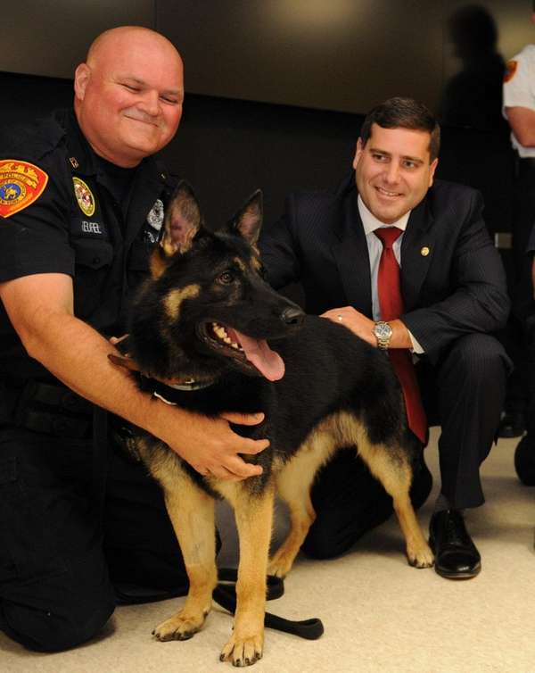 Suffolk County Police Commissioner Tim Sini, with canine