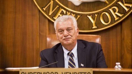 Oyster Bay Town Supervisor John Venditto looks on