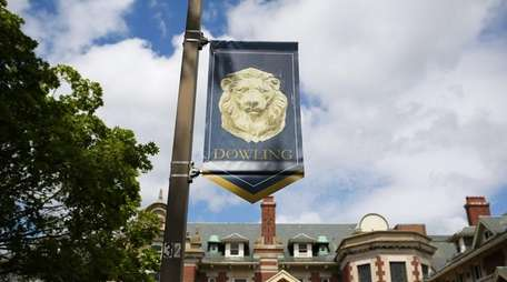 A banner for Dowling College on the school's