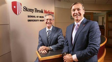 Stony Brook University President Dr. Samuel Stanley, right,