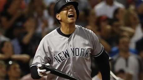 New York Yankees' Alex Rodriguez reacts to flying