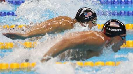 U.S. swimmers Ryan Lochte, right, and Michael Phelps