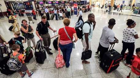 Delta Air Lines passengers, like these at Hartsfield-Jackson