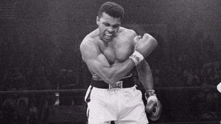 Heavyweight champion Muhammad Ali stands over fallen challenger