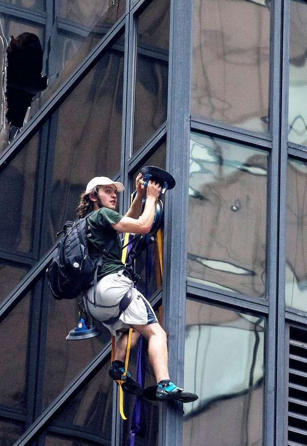 A man climbs the side of Trump Tower