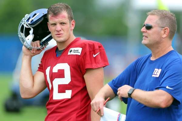 Giants quarterback Ryan Nassib talks with quarterbacks coach
