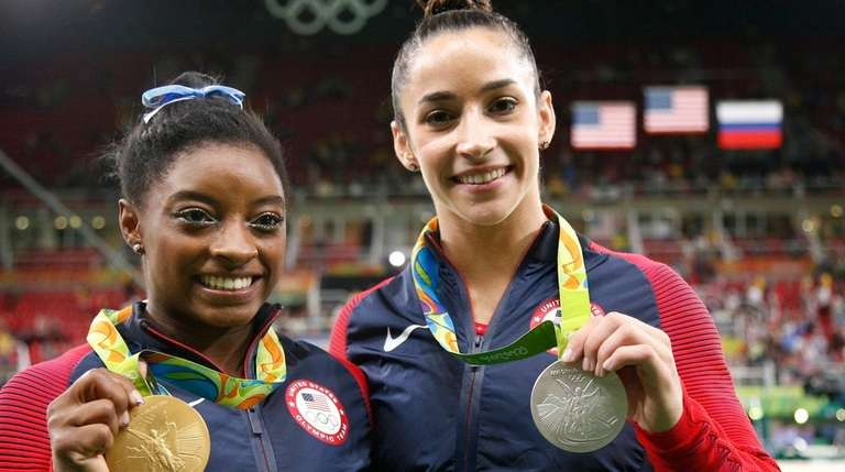 The United States' Simone Biles, left, and compatriot