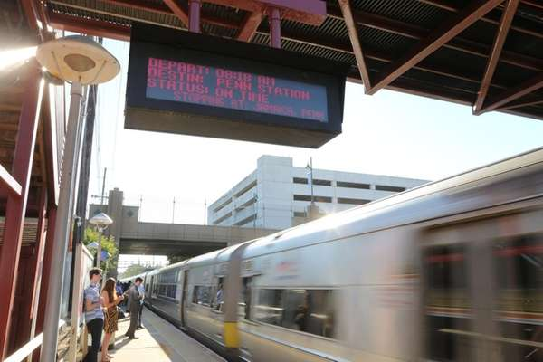On-time signs are seen at the LIRR station