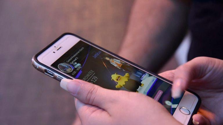 A user plays Pokemon Go on Main Street