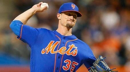 Logan Verrett of the New York Mets pitches