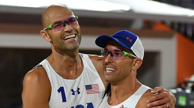 USA's Phil Dalhausser, left, and Nicholas Lucena celebrate