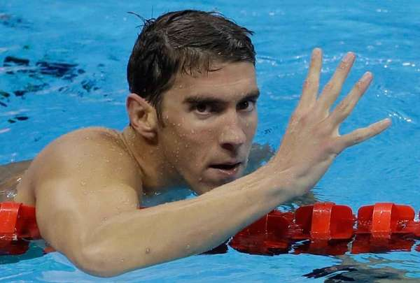 United States' Michael Phelps celebrates winning gold in