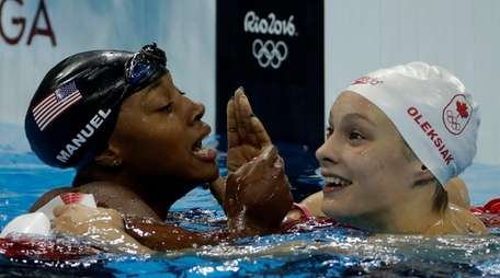 The United States' Simone Manuel, left, and Canada's