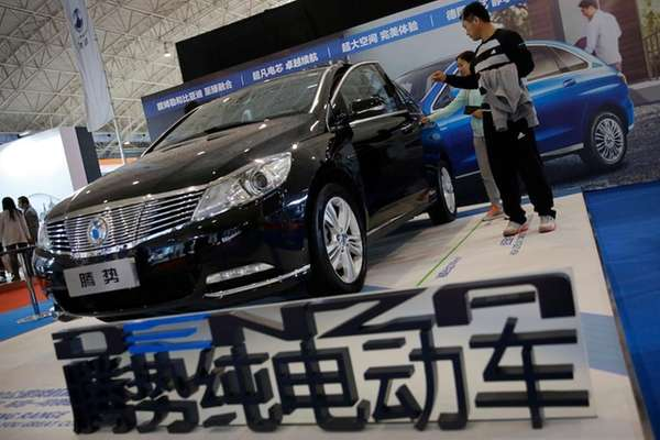 Visitors examine a Chinese automaker Denza electric vehicle