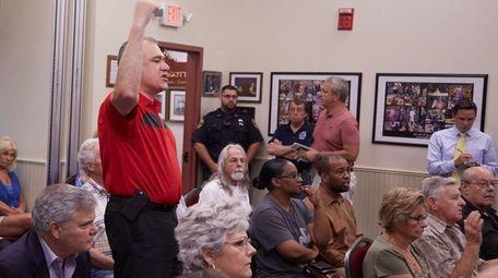 Martin Dettling protests as Village Mayor Allan M.