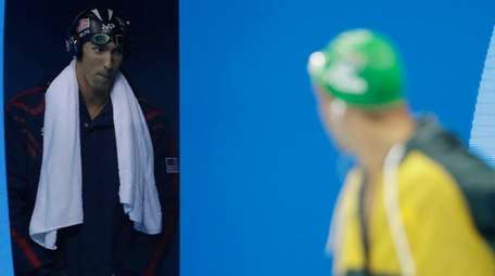 United States' Michael Phelps, left, and South Africa's