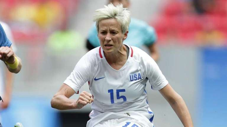 United States' Megan Rapinoe, kicks the ball past