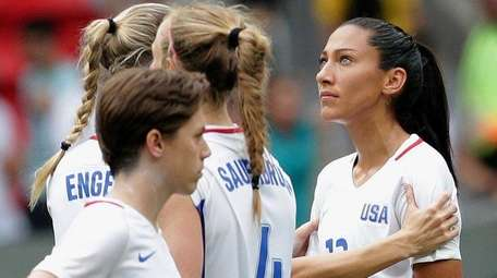 United States' Christen Press is comforted by a