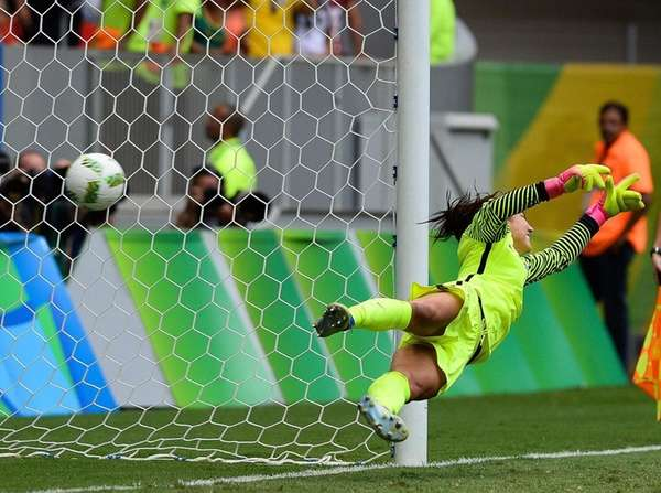 USA goalkeeper Hope Solo concedes a goal during