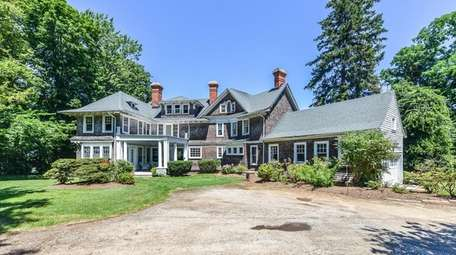 This seven-bedroom Huntington Bay Victorian was once part