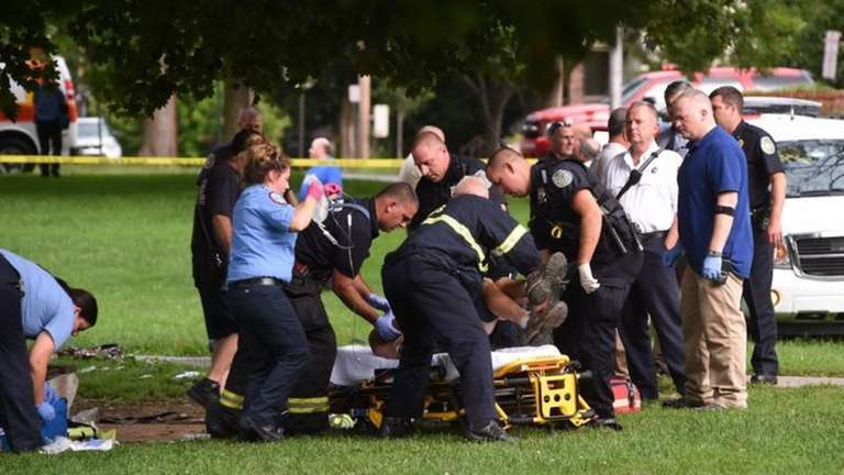 Emergency personnel put an unidentified victim possibly injured