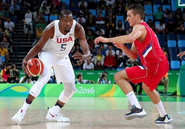 Kevin Durant #5 of United States drives on
