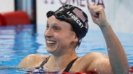 The USA's Katie Ledecky celebrates winning the women's