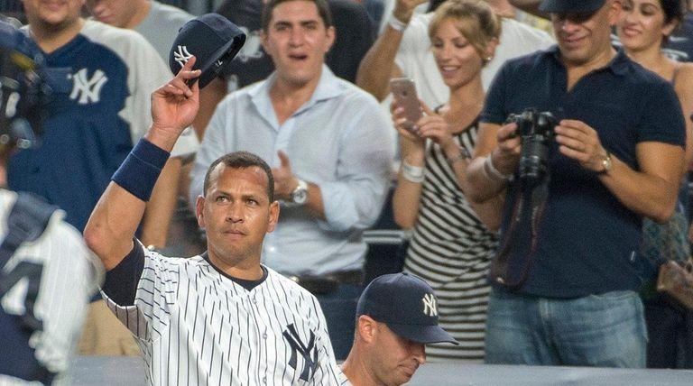 New York Yankees' Alex Rodriguez waving to the