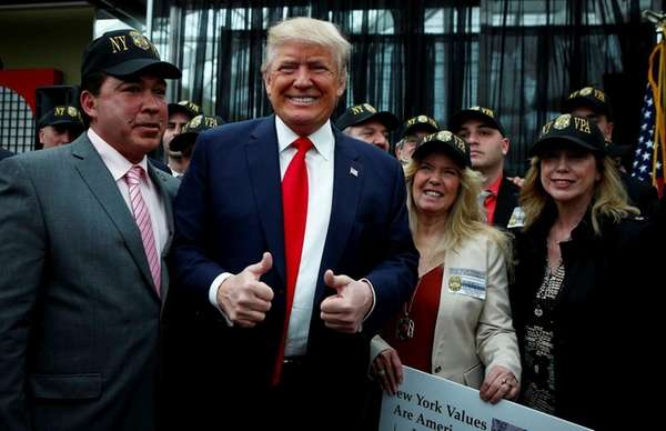 Republican presidential candidate Donald Trump with supporters at