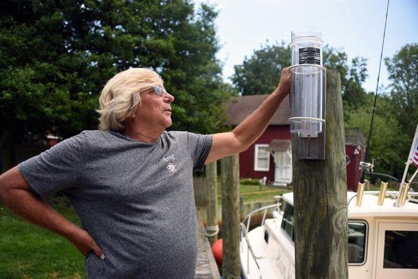 Using a simple gauge, volunteer weather watcher Barry