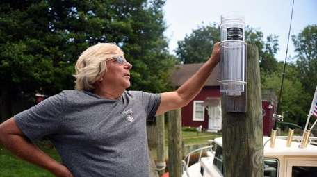 Using a simple gauge, volunteer weather watcher Barry